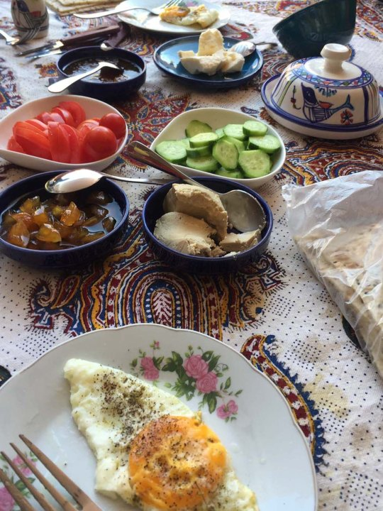 Breakfast served at most places have the basic of an egg and cheese coupled with fruits or jellied figs and a warm white and sweet sesame paste too.